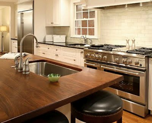 Hardwood countertops and islands bring the warmth and character of a farmhouse kitchen.